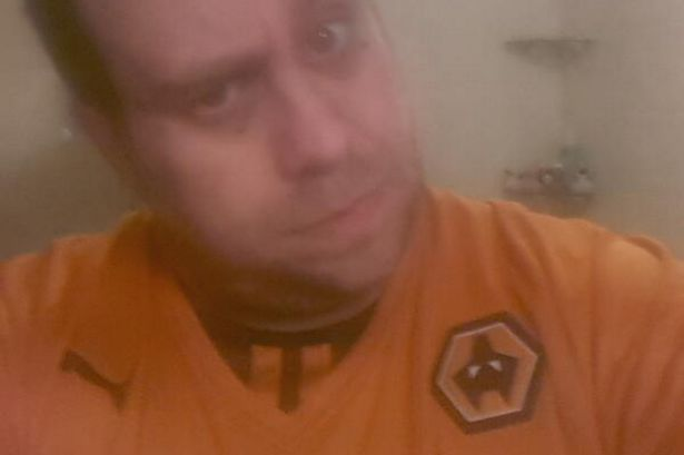 Richard-Hughes-with-the-upside-down-Wolves-badge-Picture-from-Richards-Twitter